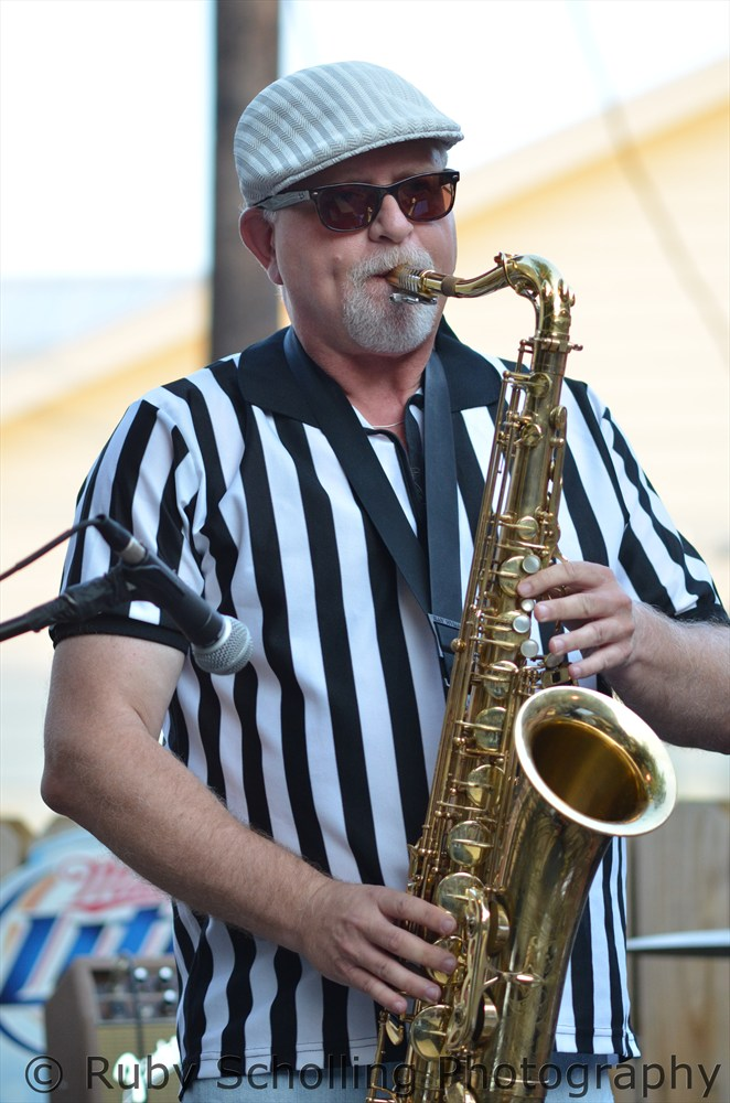 Picture of Paul Maine playing the saxophone